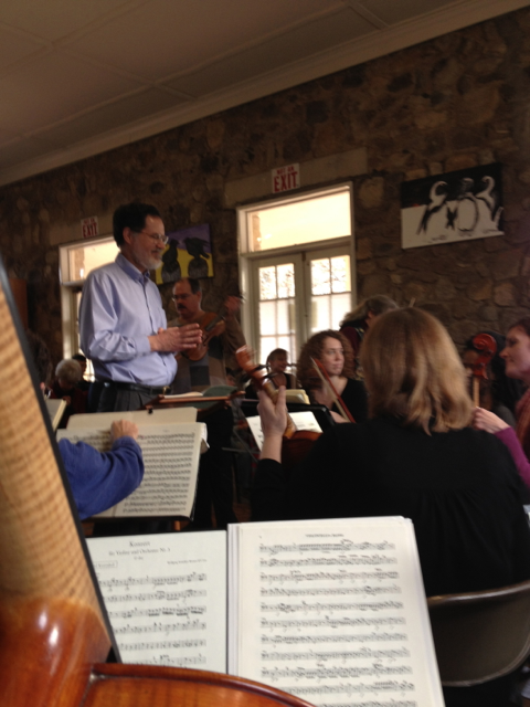 A cellist's view of the Pittsboro Bach Society.  Here you can see Dean, the fearless conductor, and Brian, the solist, behind him.