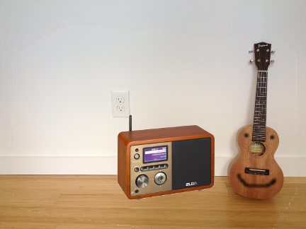 The ukulele knows he can't live without his radio!