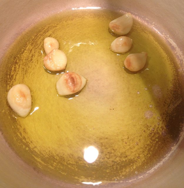 Step 2: Cover the pot and cook the garlic over low heat for 30 minutes. After 30 minutes, the garlic should be soft and lightly browned on one side.