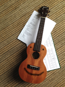 "The ukulele is hard at work learning ""Turn on the Radio""."