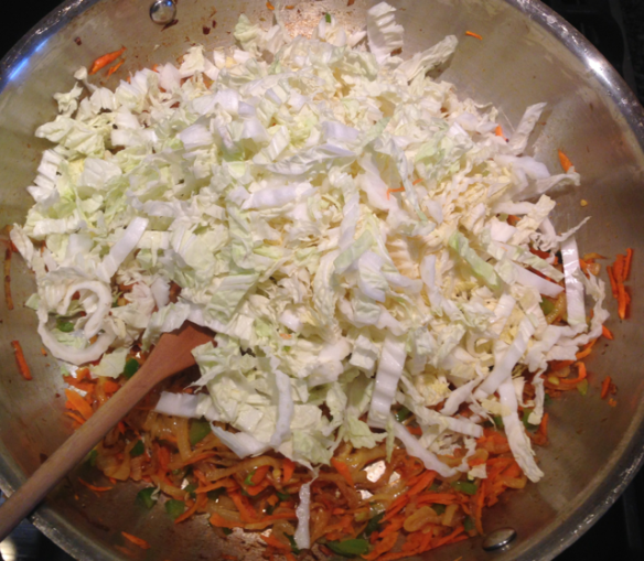 Here I have just added the napa cabbage to the pan.
