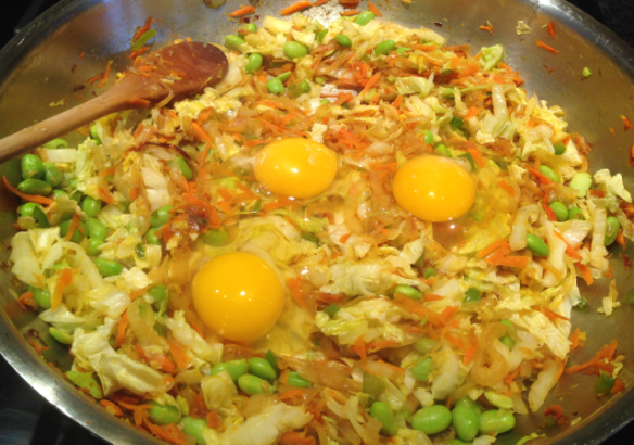I've just add the eggs. Now all I need to do is stir them in and cook until scrambled.