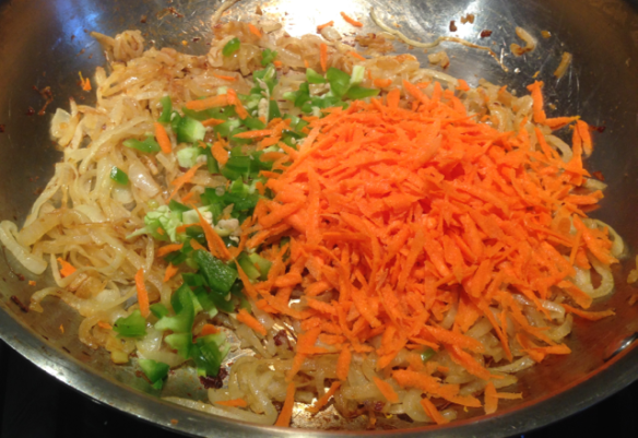 Now I've added the the grated carrots and diced poblano pepper.
