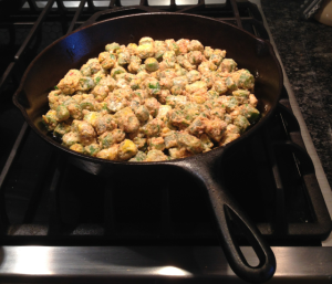 I've just added the okra mixture to the hot pan with the oil.