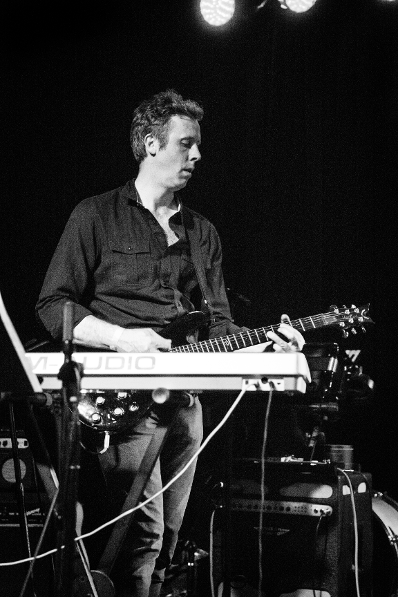 Brian plays guitar and keyboards. His job is to fill out the sound and keep things interesting.